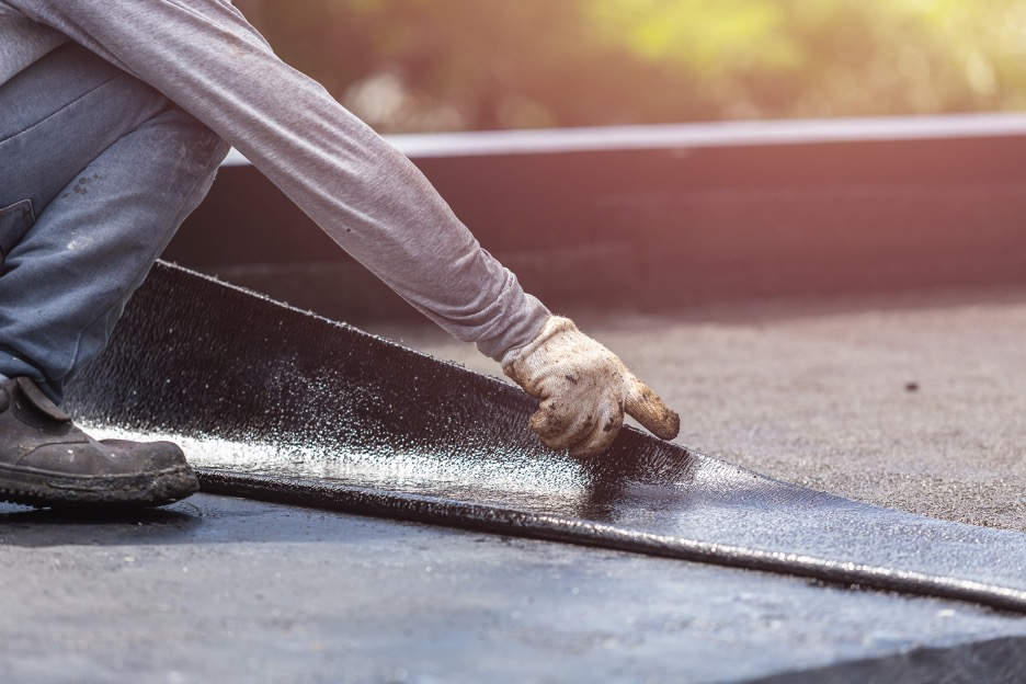 Flat roofing maintenance at a commercial building in St. Charles, Illinois